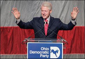 Bill Clinton told state Democratic Party leaders that they have to give voters a reason to show up at the polls. He spoke at Friday's fund-raiser in  Columbus.