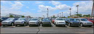 Jeep Cherokees are lined up outside Yark Automotive in Toledo. The dealership says the new Cherokee has become its best-selling Jeep.