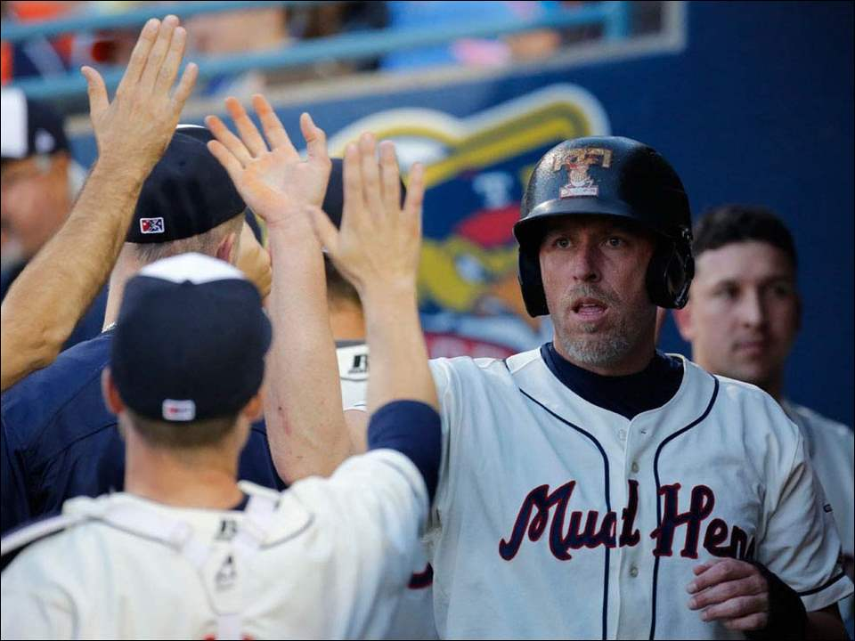 Toledo Mud Hens' Mike Hessman celebrates scoring a run against Buffalo.