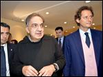 Fiat Chairman John Elkann, right, and Fiat and Chrysler CEO Sergio Marchionne arrive for a meeting with shareholders earlier this year in Turin, Italy.