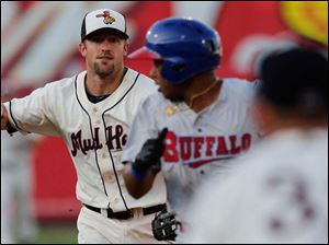 Toledo Mud Hens second baseman Danny Worth catches Buffalo Bisons' Adron Chambers in a rundown during the fourth inning.