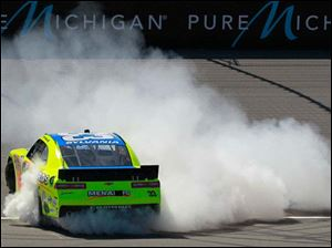 Paul Menard burns rubber to celebrate his victory.