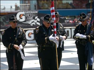 The Honor Guard from Lenawee County prepare to kick off the start of the race