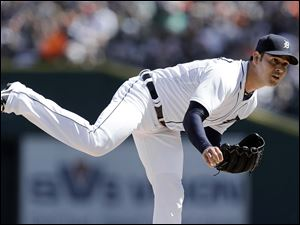 Detroit Tigers pitcher Anibal Sanchez throws against the Minnesota Twins.