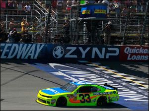 Paul Menard crosses the finish line to win the Ollie's Bargain Outlook 250.