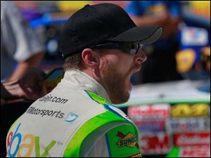 Dale Earnhardt Jr. yawns during a long delay in qualification.