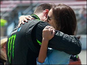 Kyle Busch and his wife Samantha Busch hug prior to the start of Ollie's Bargain Outlook 250.