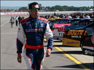 Sam Hornish Jr. walks to his #20 car to qualify.