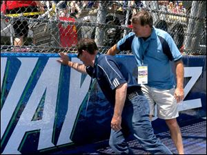 Indiana residents Dan Hudson, left, and Roger Learey touch the wall at the finish line prior to the start of the race.
