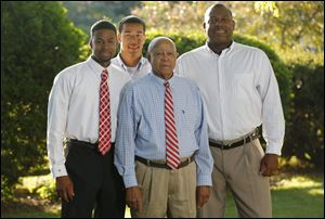 Theo Hill with his sons Chris, left, and Eric and Grandson Vincent, 17.