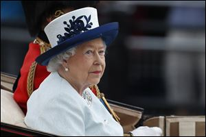Britain's Queen Elizabeth II, leaves Buckingham Palace in a horse drawn carriage to attend the Trooping the Colour parade today in central London.
