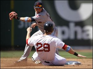 Boston Red Sox's Daniel Nava is out on a steal attempt as Cleveland Indians shortstop Asdrubal Cabrera, top, tags him.