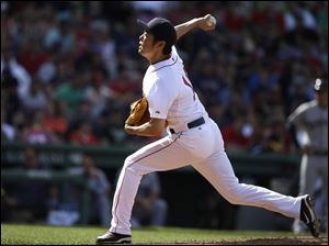 Boston Red Sox relief pitcher Koji Uehara delivers against the Cleveland Indians.