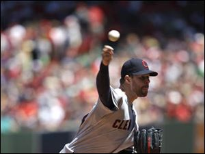 Cleveland Indians starting pitcher Corey Kluber delivers against the Boston Red Sox.