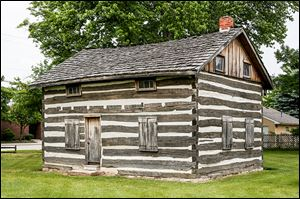The historic log house will be the last stop of the Whitehouse sesquicentennial parade featuring many floats on July 5.
