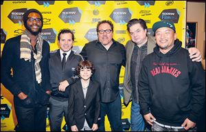 Chef Roy Choi, right, with the cast of 'Chef' — from left, Gary  Clark, Jr., John Leguizamo, Emjay Anthony, Jon Favreau, and Oliver Platt — at the premiere of the movie, directed by Favreau.
