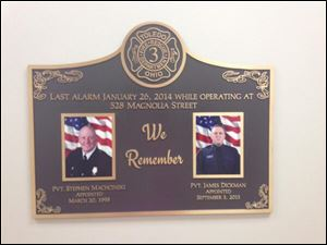 A plaque honoring fallen Toledo firemen Steve Machcinski and James Dickman hangs in the newly renovated Station No. 3.