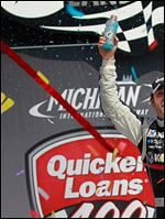 Jimmie Johnson celebrates his Quicken Loans 400 victory at Michigan International Speedway.