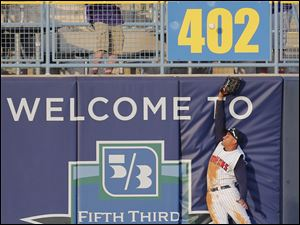Toledo Mud Hens CF Ezequiel Carrera goes to the wall and can't catch a hit by Scranton/Wilkes-Barre's Scott Sizemore.