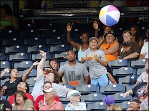 Fans play with a beach ball.