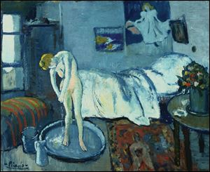 This undated handout image provided by The Phillips Collection shows Picasso's The Blue Room, painted in 1901.