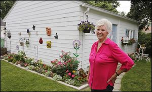 Yvonne Andrzejak's garden in Maumee will be among eight featured when Toledo Day Nursery hosts its annual garden tour, '‍In Another Garden,'‍ from 8 a.m. to 4 p.m. Saturday. The tour serves as a fund-raiser.