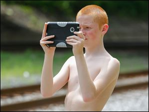 Brent Newman, 13, Toledo, photographs the Nickel Plate 765.