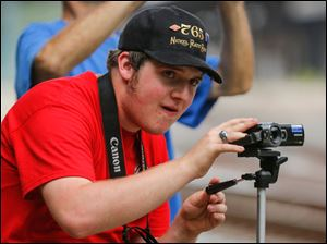 Nick Dombi, 18, Toledo, videotapes the Nickel Plate 765.