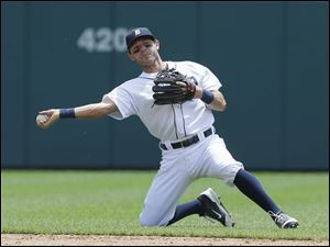 Detroit Tigers second baseman Ian Kinsler throws out Kansas City Royals' Omar Infante.