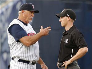 Toledo Mud Hens manager Larry Parrish argues a call with umpire Brian deBrauwere.