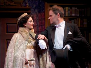 Eliza Doolittle (Natalie Ballenger) and Henry Higgins (Ted Christopher) get set to step out in the Ohio Light Opera production of '‍My Fair Lady.'
