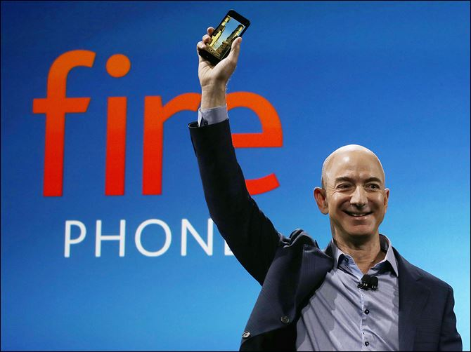 b5amazon Amazon CEO Jeff Bezos introduces the Fire phone during a Wednesday news conference in Seattle.