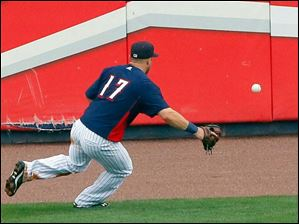 Mud Hens left field Tyler Collins fields the ball off of the wall.