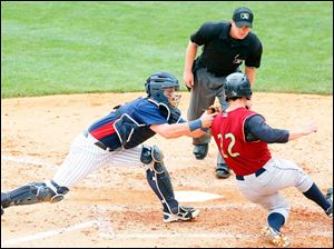 Mud Hens catcher James McCann tags out Scranton/Wilkes-Barre's Scott Sizemore at home.