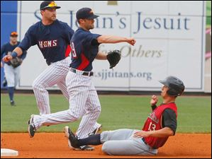 Mud Hens shortstop Danny Worth makes a double play while Scranton/Wilkes-Barre's Rob Refsnyder slides for the bag at second.