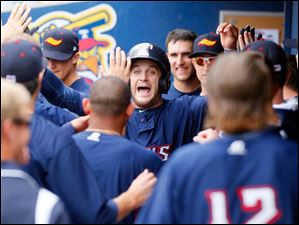 Mud Hens' Trevor Crowe celebrates his home run with his teammates.