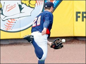 Mud Hens Trevor Crowe almost makes the catch.