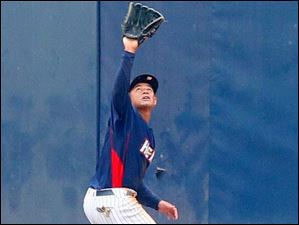 Mud Hens Ezequiel Carrera makes the catch.