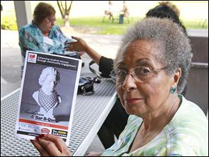 Wilma Brown holds up a Beethoven & Bar-B-Que flyer at the Partners in Education event at the Anderso