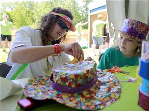 Kathy Stallons, left, works on a Duck Tape hat with her daughter Madison Stallons, 11, right, both from Swansea, Ill., at a workshop.