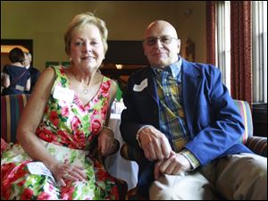 Sandra Laas, left, and Phil Kuceyeski, right, during the reception for the Toledo Symphony held at the Inverness Club.