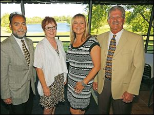 From left; Steve Cotner, Debby Peters, Jeri Wendt and Jerry O'Kenka, at the Perrysburg Rotary 35th charter night celebration at Belmont Country Club.