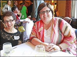 Barbara Brown, left, and Susan Conda, right, during the reception for the Toledo Symphony held at the Inverness Club.