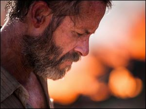 Guy Pearce portrays Eric as understated, yet menacing in 'The Rover.'