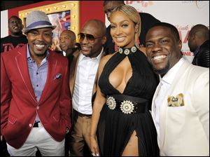 """Think Like A Man Too"" cast members Kevin Hart, right, and Alani ""La La"" Anthony, second from right, pose with boxer Floyd Mayweather Jr., second from left, and the film's producer William Packer."
