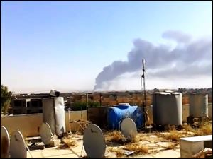 Smoke rises after an attack by al-Qaeda-inspired Islamic State of Iraq and the Levant militants on the country's largest oil refinery in Beiji, Iraq on Tuesday.