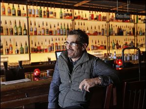 "Actor Ty Burrell, who plays bumbling dad Phil Dunphy on ABC's ""Modern Family,"" sits at the bar at Bar X, the cocktail bar he co-owns, in Salt Lake City."