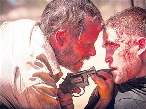 Guy Pearce and Robert Pattinson in a scene from 'The Rover.'
