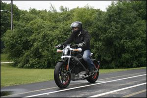 Employee Ben Lund demonstrates Harley's new electric motorcycle at Harley's research facility in Wauwatosa, Wis.