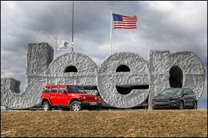 A Rubicon, left, and a 2014 Jeep Cherokee are on display at the Chrysler Toledo Assembly Complex in Toledo.